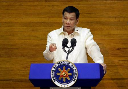 Philippine President Rodrigo Duterte delivers his State of the Nation address at the House of Representatives in Quezon city, Metro Manila, Philippines July 23, 2018.   /Czar Dancel
