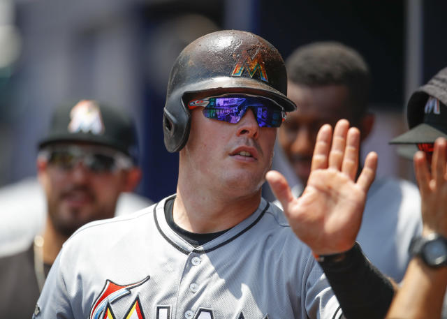 Miami Marlins Justin Bour reacts after scoring in the fourth inning of a baseball game against the Atlanta Braves, Sunday, May 20, 2018, in Atlanta. (AP Photo/Todd Kirkland)