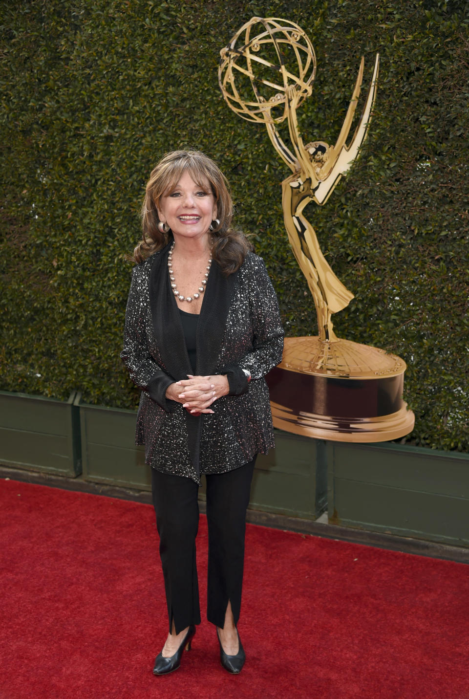 "FILE - In this April 29, 2016 file photo, Dawn Wells arrives at the Daytime Creative Arts Emmy Awards at the Westin Bonaventure Hotel in Los Angeles. Wells, who played the wholesome Mary Ann among a misfit band of shipwrecked castaways on the 1960s sitcom ""Gilligan's Island, died Wednesday, Dec. 30, 2020, of causes related to COVID-19, her publicist said. (Photo by Chris Pizzello/Invision/AP)"