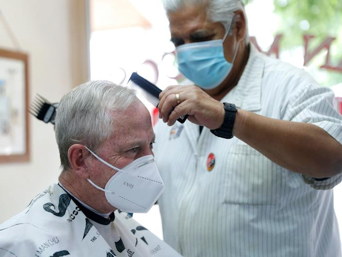 A barber gives a haircut in San Marcos, Texas.