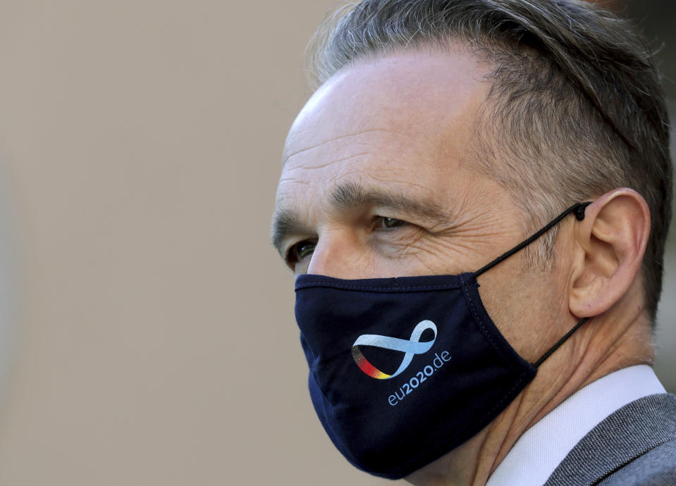 German Foreign Minister Heiko Maas, wears a face mask as he waits for the arrival of China's Foreign Minister Wang Yi for a meeting in Berlin, Germany, Tuesday, Sept. 1, 2020. (AP Photo/Michael Sohn, pool)