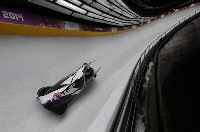 The team from the United States USA-1, piloted by Elana Meyers with brakeman Lauryn Williams, speed down the track during the women's two-man bobsled competition at the 2014 Winter Olympics, Tuesday, Feb. 18, 2014, in Krasnaya Polyana, Russia. (AP Photo/Natacha Pisarenko)
