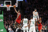 Atlanta Hawks guard Treveon Graham drives to the basket ahead of Boston Celtics defenders during the first half of an NBA basketball game, Friday, Feb. 7, 2020, in Boston. (AP Photo/Mary Schwalm)