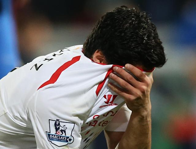 Liverpool's Luis Suarez, holds his shirt to his face following the end of the English Premier League soccer match between Crystal Palace and Liverpool at Selhurst Park stadium in London, Monday, May 5, 2014. The game ended in a 3-3 draw. (AP Photo/Alastair Grant)