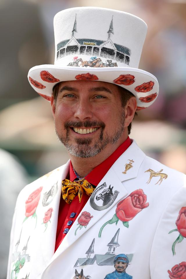 LOUISVILLE, KY - MAY 03: A race fan wearing a festive hat attends the 140th running of the Kentucky Derby at Churchill Downs on May 3, 2014 in Louisville, Kentucky. (Photo by Matthew Stockman/Getty Images)