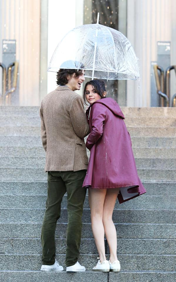 <p>The singer hit the steps of the Met — although this time there was no red carpet — in the rain while filming Woody Allen's upcoming project in his beloved New York City. (Photo: LRNYC/MEGA) </p>