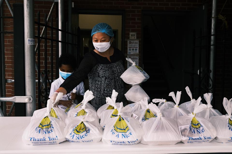 Soup kitchens, food banks and other food distribution sites — such as Thessalonica Christian Church in the Bronx, pictured here — are facing new challenges to safely feed those in need amid the pandemic. (Photo: Spencer Platt/Getty Images)