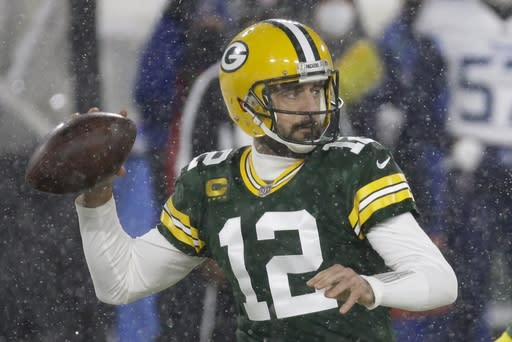 Green Bay Packers' Aaron Rodgers throws during the first half of an NFL football game against the Tennessee Titans Sunday, Dec. 27, 2020, in Green Bay, Wis. (AP Photo/Mike Roemer)