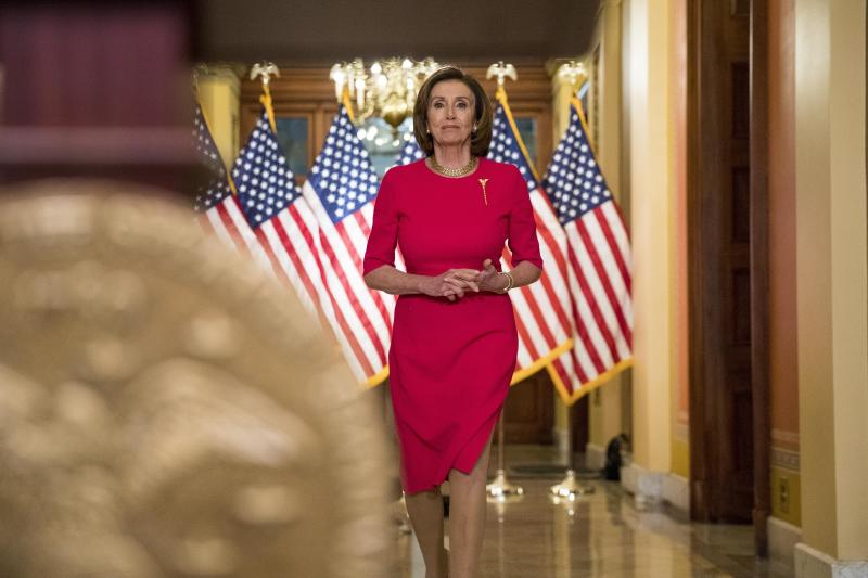 House Speaker Nancy Pelosi of Calif. arrives to read a statement outside her office on Capitol Hill, Monday, March 23, 2020, in Washington. (AP Photo/Andrew Harnik, Pool)