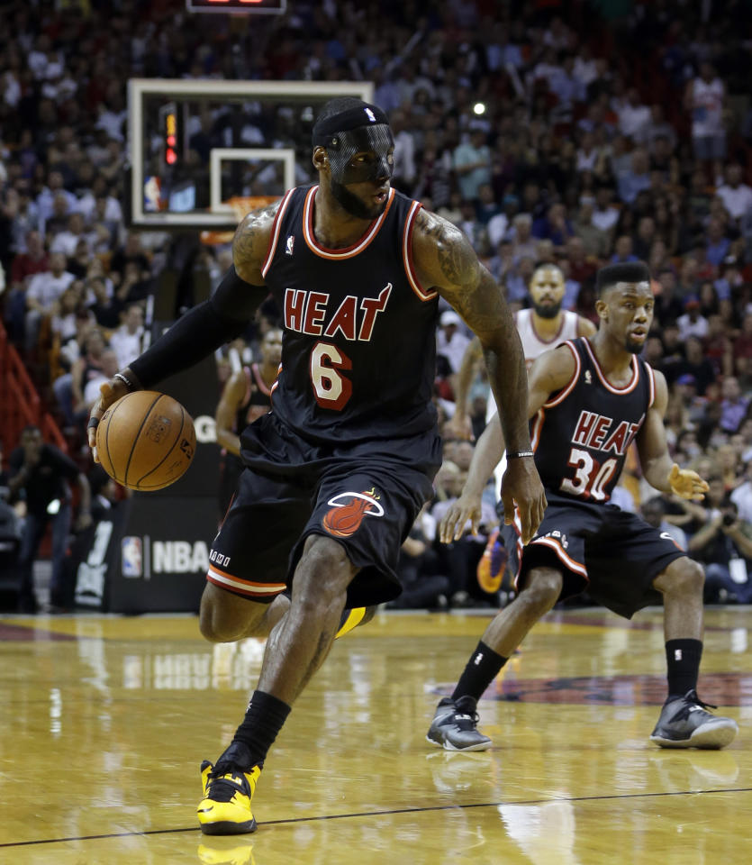 Miami Heat small forward LeBron James (6) drives against the New York Knicks during the first half of an NBA basketball game in Miami, Thursday, Feb. 27, 2014. (AP Photo/Alan Diaz)
