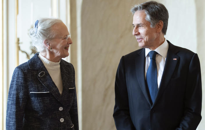 Denmark's Queen Margrethe II, left welcomes US Secretary of State Antony Blinken, during their meeting, at Amalienborg Palace in Copenhagen, Denmark, Monday, May 17, 2021. Blinken is seeing Danish leaders as well as top officials from Greenland and the Faeroe Islands in Copenhagen on Monday before he heads to Iceland for an Arctic Council meeting that will be marked by his first face-to-face talks with Russian Foreign Minister Sergey Lavrov at a time of significantly heightened tensions between Washington and Moscow. (Saul Loeb/Pool Photo via AP)