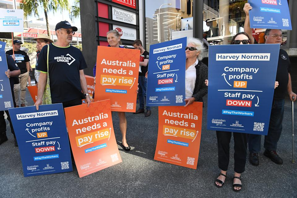 Workers protest about pay outside Harvey Norman Fortitude Valley in Brisbane on Friday. Source: AAP