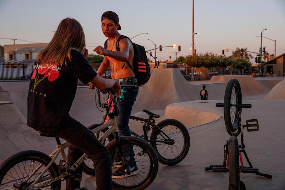 Young people hang out at Sidewinder Skatepark in El Centro, Calif., on July 7, 2021. The City of El Centro consistently ranks as having the highest unemployment rate in the country.
