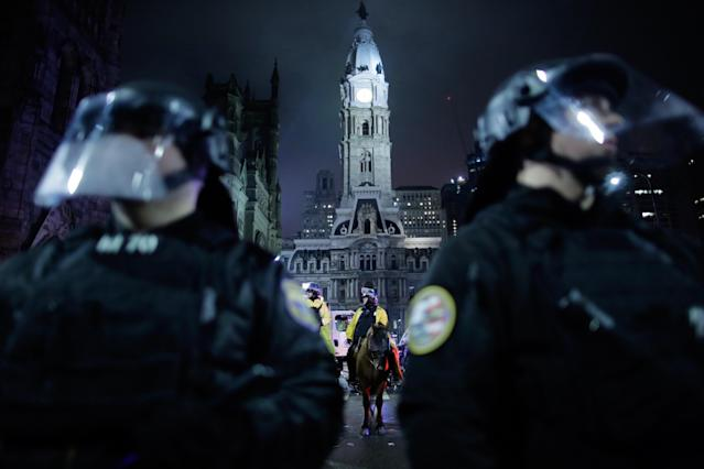 <p>Police officers stand guard as Philadelphia Eagles fans celebrate victory in Super Bowl LII game against New England Patriots on February 4, 2018 in Philadelphia, Pennsylvania..(Photo by Eduardo Munoz Alvarez/Getty Images) </p>