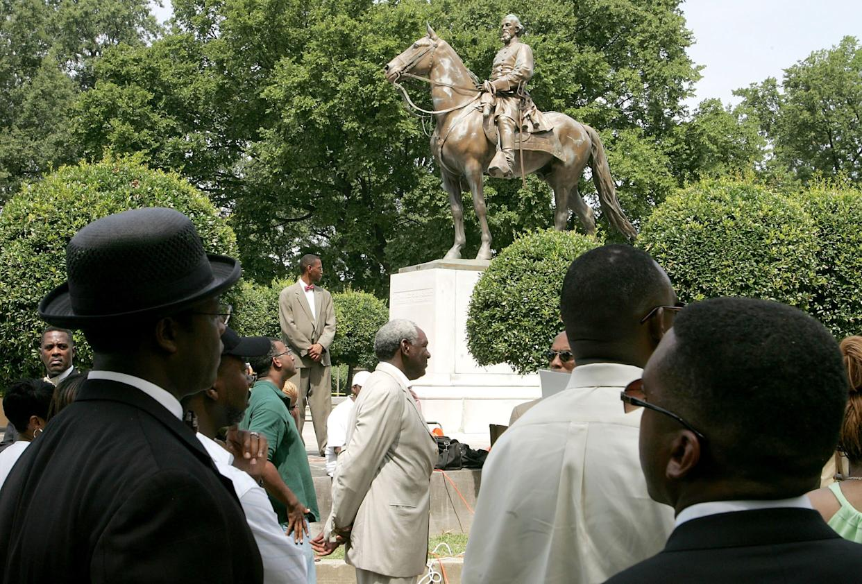 Back in 2005,protesters rallied against the name of Memphis' Nathan Bedford Forrest Park in front of a statue ofthe Confederate general. (Photo: Carlo Allegri via Getty Images)