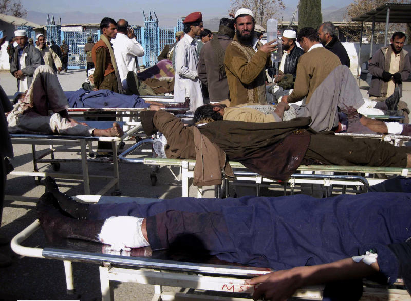 Injured victims of suicide bombing are treated at a local hospital in Khar, the main town of Pakistan's Bajur tribal region along Afghan border, Saturday, Dec. 25, 2010. A female suicide bomber detonated her explosives-laden vest killing scores of people at an aid distribution center in northwestern Pakistan while army helicopter gunships and artillery killed a similar number of Islamic militants in neighboring tribal regions near the Afghan border, officials said. (AP Photo/Anwarullah Khan)