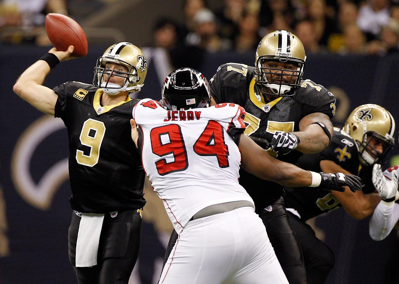 NEW ORLEANS, LA - DECEMBER 26:  Quarterback Drew Brees #9 of the New Orleans Saints passes the ball as he uses a block from offensive guard Carl Nicks #77 against defensive tackle Peria Jerry #94 of the Atlanta Falcons at the Mercedes-Benz Superdome on December 26, 2011 in New Orleans, Louisiana.  (Photo by Chris Graythen/Getty Images)