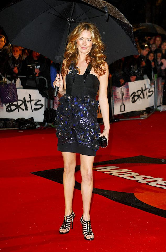 """So You Think You Can Dance"" host Cat Deeley protected her cute sparkling mini and Jimmy Choo heels with a color-coordinated black umbrella. Mike Marsland/<a href=""http://www.wireimage.com"" target=""new"">WireImage.com</a> - February 16, 2010"