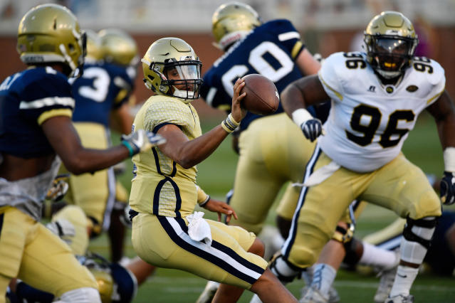 Georgia Tech quarterback Lucas Johnson pitches the ball during the NCAA college football team's spring scrimmage Friday, April 20, 2018, in Atlanta. (AP Photo/Mike Stewart)