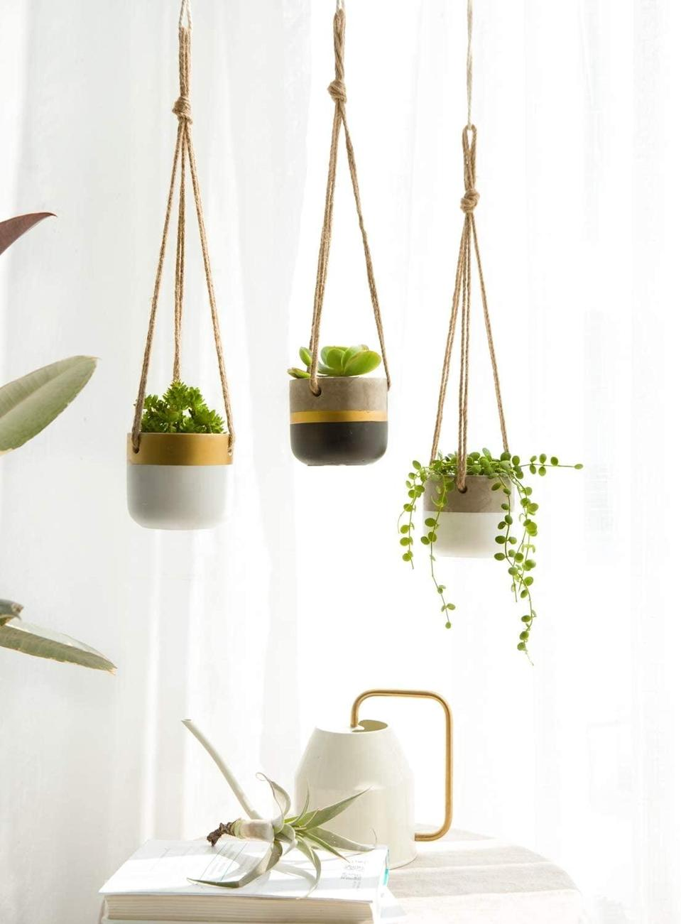 <p>From succulents to small plants, these <span>Dahey 3 Pack Small Cement Hanging Planters</span> ($20) are a great way to add accents to your decor.</p>