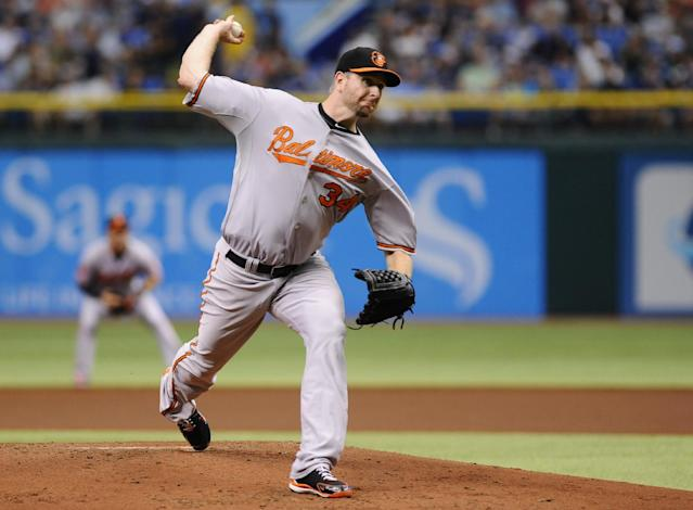 Baltimore Orioles starting pitcher Scott Feldman delivers to the Tampa Bay Rays during the first inning of an MLB American League baseball game Sunday, Sept. 22, 2013, in St. Petersburg, Fla. (AP Photo/Brian Blanco)