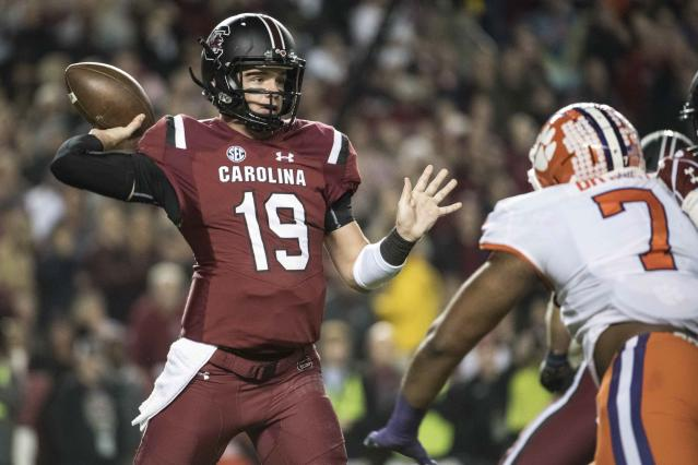 """South Carolina quarterback <a class=""""link rapid-noclick-resp"""" href=""""/ncaaf/players/269283/"""" data-ylk=""""slk:Jake Bentley"""">Jake Bentley</a> (19) attempts a pass against Clemson defensive end Austin Bryant (7) during the first half of an NCAA college football game Saturday, Nov. 25, 2017, in Columbia, S.C. (AP Photo/Sean Rayford)"""
