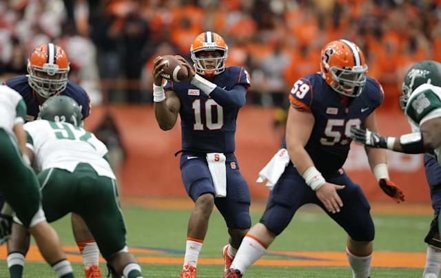 Syracuse's Terrel Hunt takes a snap in the second quarter of an NCAA college football game against Wagner in the Carrier Dome in Syracuse, N.Y., Saturday, Sept. 14, 2013. (AP Photo/Nick Lisi)