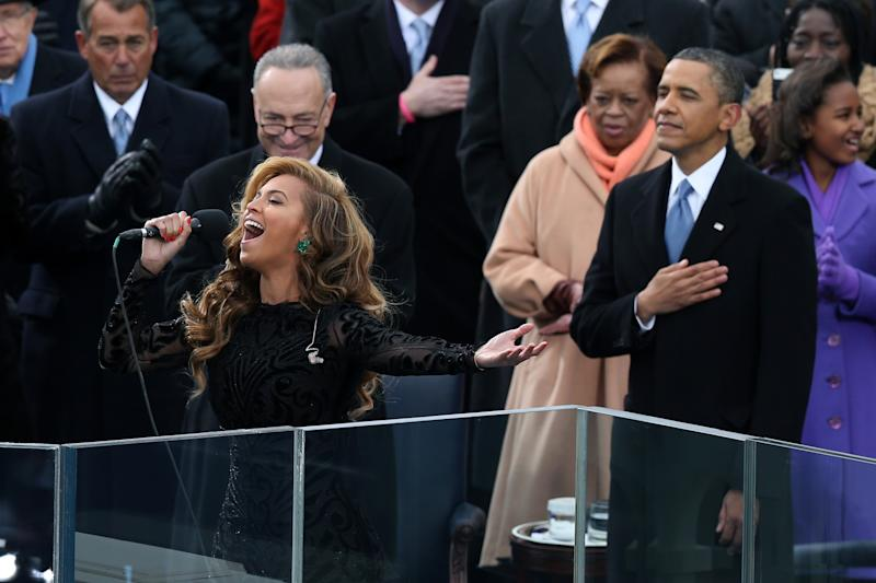 Beyoncé performs the national anthem as U.S. President Barack Obama looks on during the presidential inauguration on the West Front of the U.S. Capitol January 21, 2013 in Washington, DC. Barack Obama was re-elected for a second term as President of the United States. (Photo by Alex Wong/Getty Images)