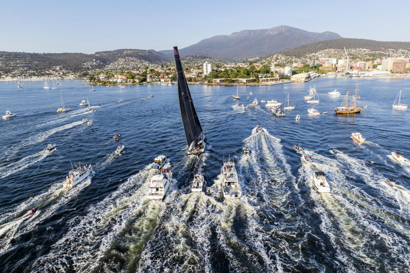 In a photo provided by Role, Comanche, center, is surrounded by spectator craft on arrival to Hobart, Australia, to claim victory in the Sydney to Hobart yacht race Saturday, Dec. 28, 2019. (Carlo Borlenghi/Rolex via AP)