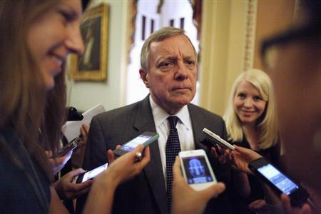 U.S. Senator Durbin talks with reporters near the U.S. Senate floor at the U.S. Capitol during immigration debates in Washington