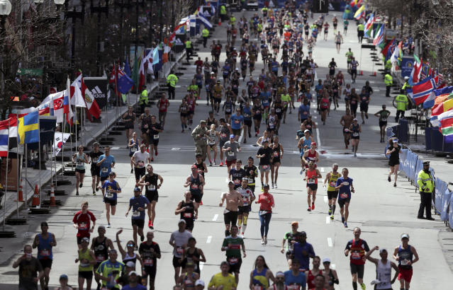 Runners race to the finish line in the 123rd Boston Marathon on Monday, April 15, 2019, in Boston. (AP Photo/Charles Krupa)