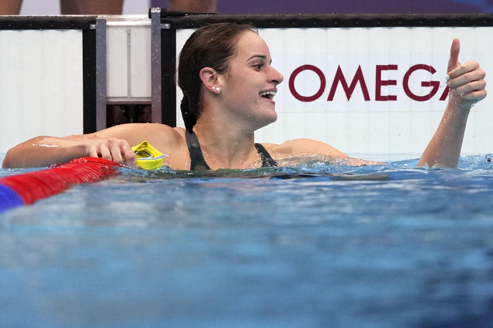 Kaylee McKeown of Australia waves after winning the final of the women's 100-meter backstroke at the 2020 Summer Olympics, Tuesday, July 27, 2021, in Tokyo, Japan. (AP Photo/Matthias Schrader)