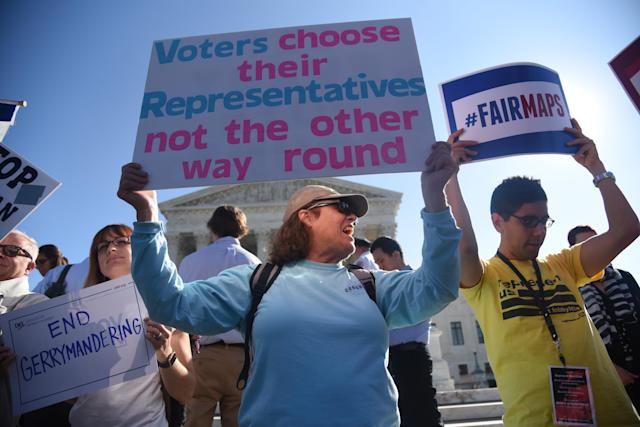 Demonstrators rally outside the Supreme Court in Washington in October 2017 during oral arguments in Gill v. Whitford case to call for an end to partisan gerrymandering. (Photo: Olivier Douliery/Getty Images)