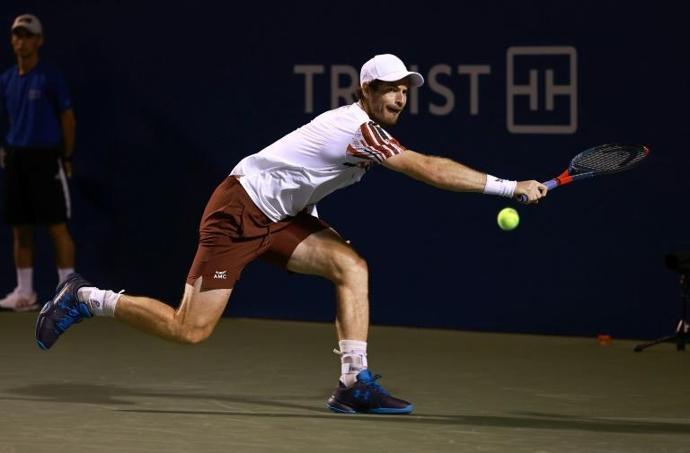 Andy Murray returns a shot to Noah Rubin during their first round match at the ATP Winston-Salem Open