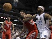 Dallas Mavericks' Vince Carter (25) and Houston Rockets' Luis Scola, center, compete for a loose ball as Rockets' Chandler Parsons (25) looks on in the first half of an NBA basketball game on Wednesday, April 18, 2012, in Dallas. (AP Photo/Tony Gutierrez)