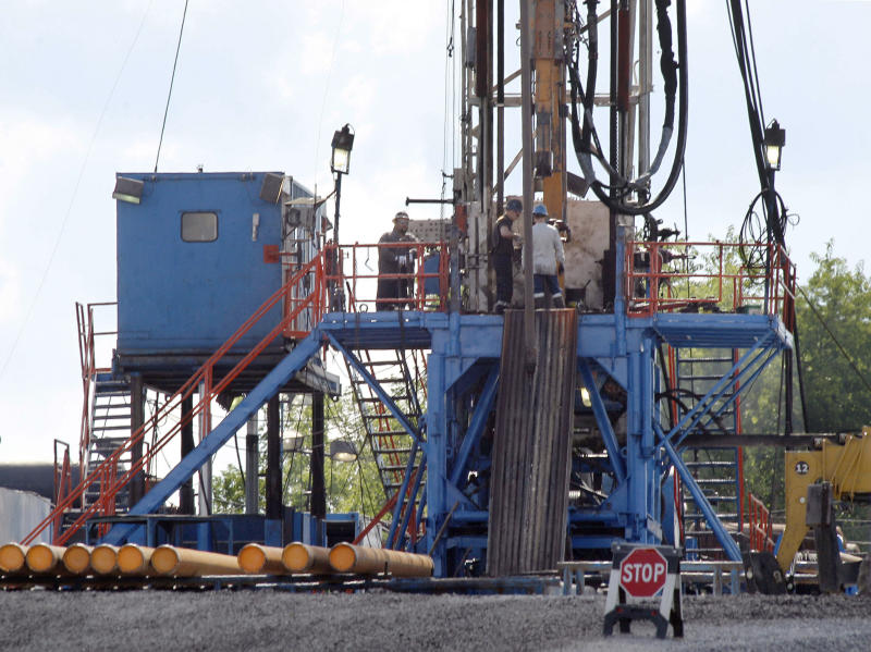 **HOLD FOR STORY BY MARK SCOLFORO** FILE - In this June 25, 2012 file photo, a crew works on a gas drilling rig at a well site for shale based natural gas in Zelienople, Pa.  A seven-judge Commonwealth Court panel on Monday, July 22, 2019, issued a 91-page decision upholding Pennsylvania regulations regarding Marcellus Shale natural gas drilling in a complex decision that also ruled in part on the side of an industry group. (AP Photo/Keith Srakocic, File)