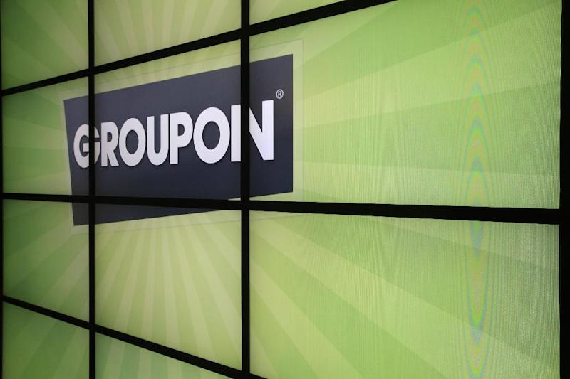 FILE - This Oct. 21, 2011 file photo shows the Groupon logo inside the online coupon company's offices, in Chicago. Groupon Inc., said Monday, Aug. 13, 2012, that its second-quarter earnings beat Wall Street's profit estimates, but it underwhelmed analysts with sales growth hurt by unfavorable currency movements. (AP Photo/Charles Rex Arbogast, File)