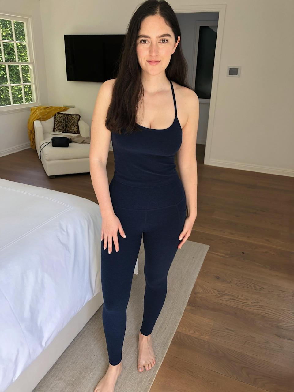 <p>It's me in my uniform, also known as the <span>Beyond Yoga Spacedye Out of Pocket High Waisted Midi Legging</span> ($99) and <span>Beyond Yoga Spacedye Slim Racerback Cropped Tank</span> ($66). I have three colors, but am partial to this navy blue.</p>