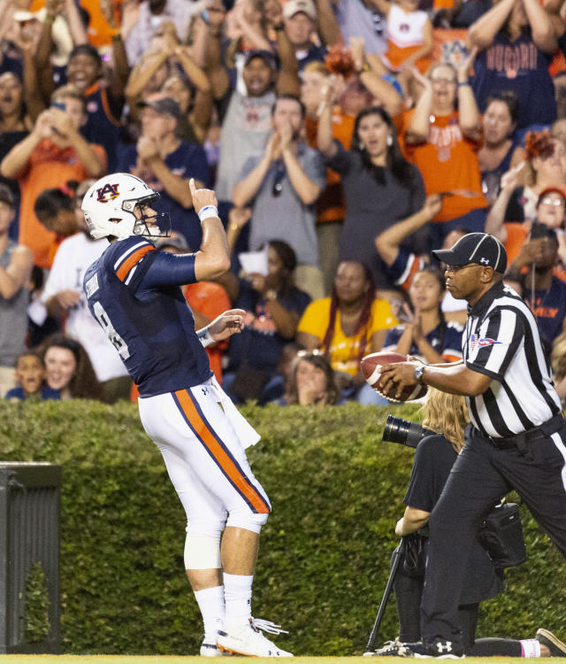 Auburn quarterback Jarrett Stidham salutes the crowd after scoring the first touchdown of the night against Alabama State in an NCAA college football game Saturday, Sept. 8, 2018, in Auburn, Ala. (AP Photo/Vasha Hunt)