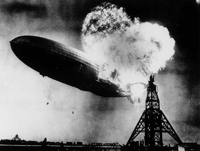 <p>This May 6, 1937 file photo, taken at almost the split second that the Hindenburg exploded, shows the 804-foot German zeppelin just before the second and third explosions send the ship crashing to the earth over the Lakehurst Naval Air Station in Lakehurst, N.J. The roaring flames silhouette two men, at right atop the mooring mast, dangerously close to the explosions. (AP Photo) </p>