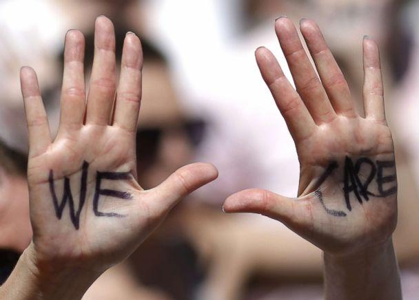 PHOTO: 'We Care' is written on a protester's hands during a march from Freedom Plaza to demonstrate against family detentions and to demand the end of criminalizing efforts of asylum seekers and immigrants June 28, 2018 in Washington, D.C. (Win McNamee/Getty Images)