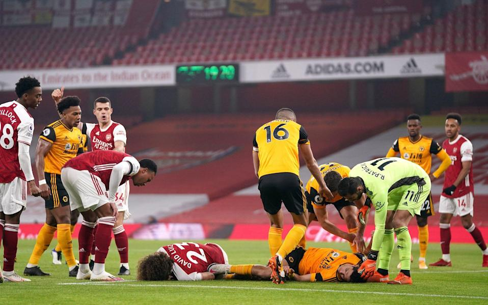 Raul Jimenez received oxygen on the pitch after the incident - John Walton/PA