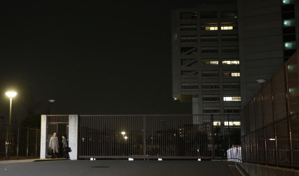 Motonari Otsuru, left, defense lawyer of former Nissan chairman Carlos Ghosn, leaves the Tokyo Detention Center where Ghosn and another former executive Greg Kelly are being detained in Tokyo, Thursday, Dec. 20, 2018. The Tokyo District Court on Thursday rejected the request for another 10-day detention over Ghosn's indictment for falsification of financial reports. (AP Photo/Shuji Kajiyama)