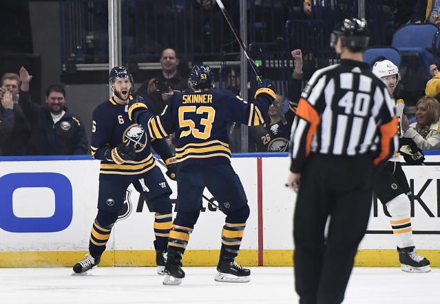 Buffalo Sabres defenseman Marco Scandella, left, celebrates his goal with left wing Jeff Skinner (53) during the first period of an NHL hockey game against the Boston Bruins in Buffalo, N.Y., Saturday, Dec. 29, 2018. (AP Photo/Adrian Kraus)