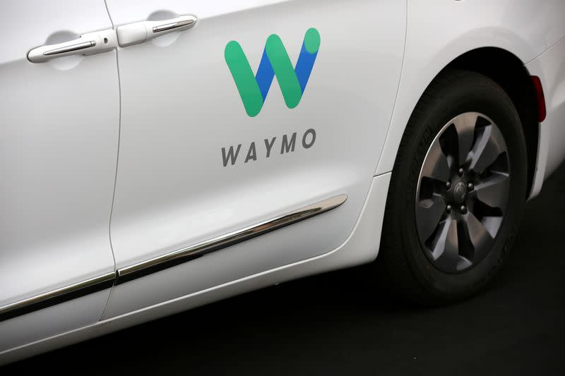 FILE PHOTO: A Waymo Chrysler Pacifica Hybrid self-driving vehicle is parked and displayed during a demonstration in Chandler, Arizona