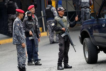 Members of the Bolivarian National Intelligence Service (SEBIN) stand guard outside a detention center of the Bolivarian National Intelligence Service (SEBIN), where a riot occurred, according to relatives, in Caracas, Venezuela May 16, 2018. REUTERS/Carlos Garcia Rawlins