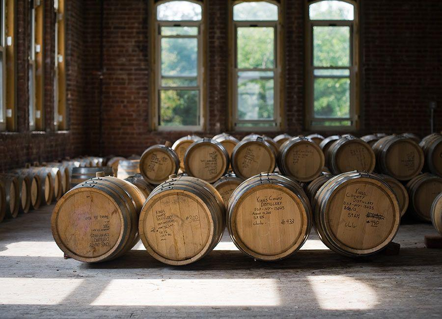 """<p>Founded in 2010, Kings County Distillery began in a 325-square-foot room in East Williamsburg and now operates out of the 118-year-old Paymaster Building in the Brooklyn Navy Yard. Stop by for a <a href=""""http://kingscountydistillery.com/tours/"""" rel=""""nofollow noopener"""" target=""""_blank"""" data-ylk=""""slk:tour or tasting"""" class=""""link rapid-noclick-resp"""">tour or tasting</a>—the Gatehouses at the entrance to the Navy Yard serves the whiskeys in cocktails, pours, and tasting flights.</p>"""