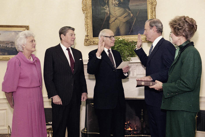 Baker is sworn in as Treasury secretary at the White House in February 1985.