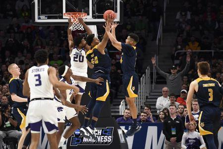 Mar 22, 2019; San Jose, CA, USA; UC Irvine Anteaters forward Elston Jones (50) and guard Evan Leonard (14) go for a rebound as Kansas State Wildcats forward Xavier Sneed (20) looks on during the second half in the first round of the 2019 NCAA Tournament at SAP Center. Mandatory Credit: Kelley L Cox-USA TODAY Sports