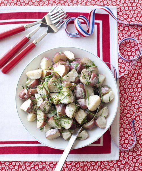 """<p>Low-fat buttermilk and light mayo means you can double up on a serving of spuds, sans regrets.</p><p><a href=""""https://www.goodhousekeeping.com/food-recipes/a10165/light-creamy-potato-salad-recipe-ghk0710/"""" rel=""""nofollow noopener"""" target=""""_blank"""" data-ylk=""""slk:Get the recipe for Light and Creamy Potato Salad »"""" class=""""link rapid-noclick-resp""""><em>Get the recipe for Light and Creamy Potato Salad »</em></a></p>"""